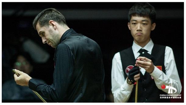 Марк Селби (слева) и Luo Honghao (справа)